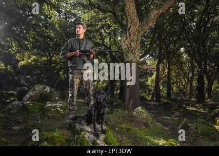 Hunter and pet dog in the forest. La Ahumada, Tarifa, Cadiz, Andalusia, Spain. - Stock Photo