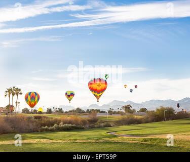 Hot Air Balloon Ascend over a golf course in Lake Havasu City, Arizona - Stock Photo