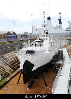 HMS M33 an M29 Class Monitor of the Royal Navy, ready to be opened to the public in 2015 at Portsmouth Historic - Stock Photo