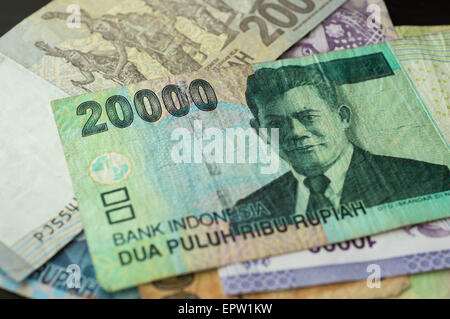 Some banknotes of Indonesian rupiah - Stock Photo