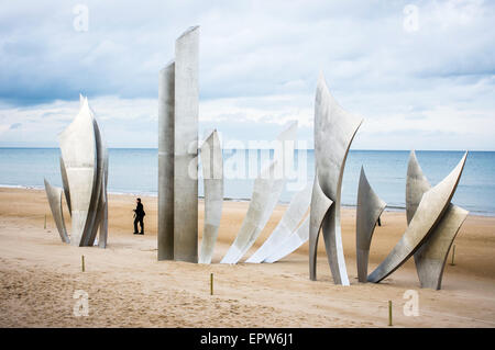 The impressive metal sculpture called Les Braves at Omaha Beach in Normandy, France. This is a monument to the dead - Stock Photo