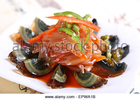 fried preserved egg and bullwhip - Stock Photo