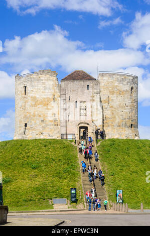 A party of school children descending the steps at Clifford's Tower. York, England - Stock Photo