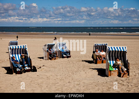Strandkorb - beach chairs on the main beach, East Frisian Island Spiekeroog, Lower Saxony, Germany - Stock Photo