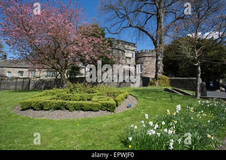 Town of Skipton, England. Picturesque spring view of the twin towered Norman gatehouse of Skipton Castle. - Stock Photo