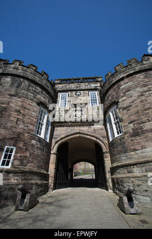 Town of Skipton, England. Picturesque view of the twin towered Norman gatehouse of Skipton Castle. - Stock Photo
