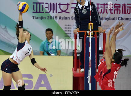 Tianjin, China. 21st May, 2015. Lee Jaeyeong (L) of South Korea spikes the ball during a Group D match against Philippine - Stock Photo
