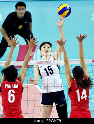 Tianjin, China. 21st May, 2015. Moon Jungwon (C) of South Korea spikes the ball during a Group D match against Philippine - Stock Photo