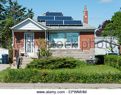 Solar energy panels in private house, practical  use of solar energy is becoming more popular in Canada, some houses - Stock Photo