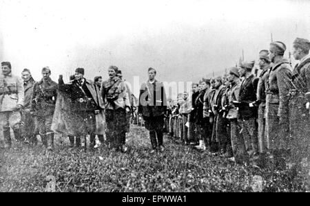 JOSIP BROZ TITO (1892-1980) at left with arm raised inspecting his Partisans about 1943. - Stock Photo