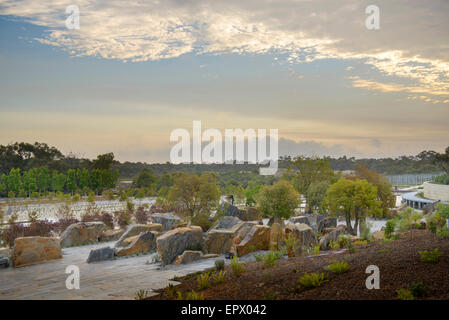 Trees and rocks in the Royal Botanic Gardens, Cranbourne, Australia - Stock Photo