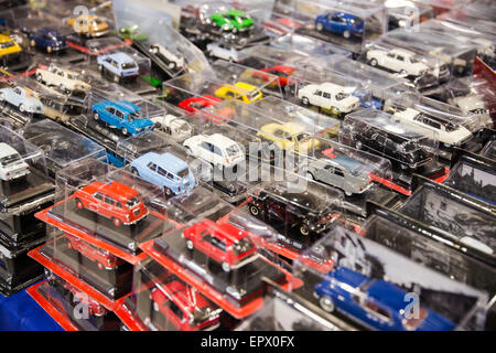 many toy cars colored still closed in transparent packaging - Stock Photo