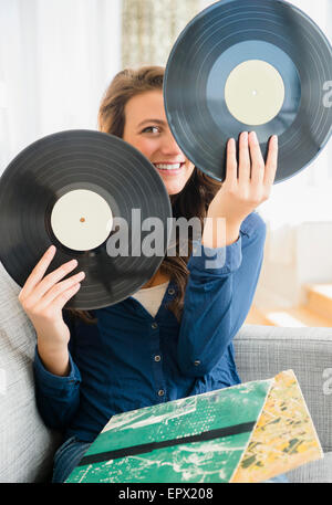 Woman holding two vinyl records - Stock Photo