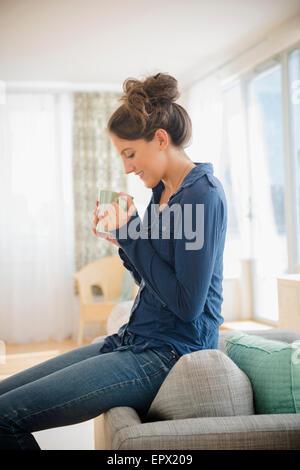 Woman at home with mug