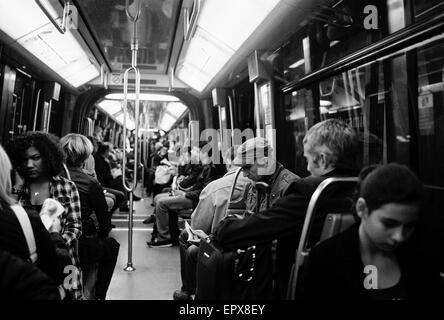 AJAXNETPHOTO. PARIS, FRANCE. - METRO LIFE - SPACIOUS CITY METRO CARRIAGE, NOT RUSH HOUR. PHOTO:JONATHAN EASTLAND/AJAX - Stock Photo