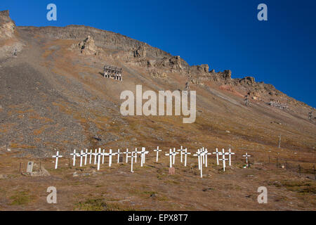 White wooden crosses on graves at the old cemetery of Longyearbyen in summer, Svalbard / Spitsbergen, Norway - Stock Photo