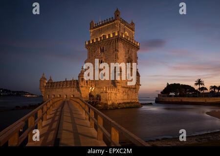 Torre de Belem (tower of Belem) at dusk. - Stock Photo