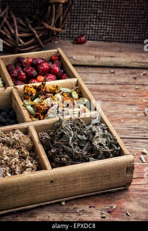 wooden box with herbs traditional medicine from home kit in the rural style.Selective focus - Stock Photo