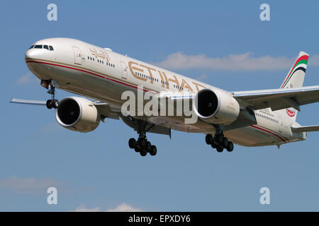 Boeing 777-300ER long-haul widebody airliner belonging to Abu Dhabi airline Etihad on approach. Close-up front view. - Stock Photo