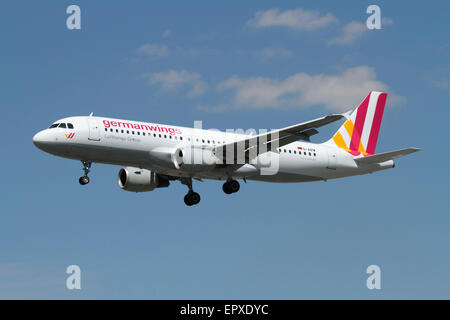 Low cost air travel. Airbus A320 passenger jet belonging to budget airline Germanwings on approach - Stock Photo