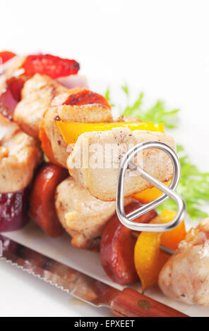 Grilled meat and vegetables on skewers - Stock Photo