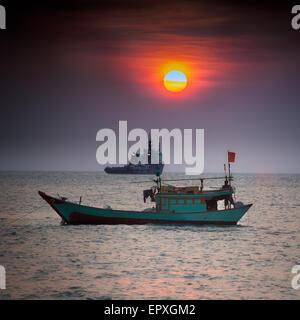 Small fishing boat in South China Sea, Vung Tau, Vietnam - Stock Photo