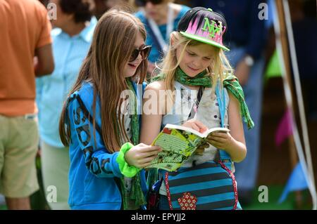 Hay on Wye. Wales UK. Saturday 23 May 2015  Two young visitors enjoying the sunshine at the Hay Literature Festival - Stock Photo
