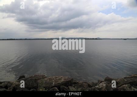 Calm lake water Polonnaruwa, North Central Province, Sri Lanka, Asia - Stock Photo