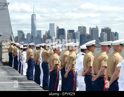 US Sailors and Marines man the rails during the Parade of Ships at Fleet Week May 20, 2015 in New York City, NY. - Stock Photo
