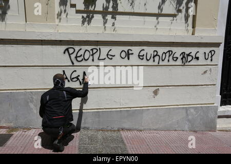 Athens, Greece. 23rd May 2015. A protesters burns paints a graffiti on a wall near the German Embassy that reads - Stock Photo