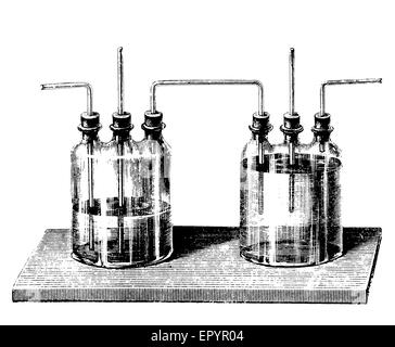 Vintage chemistry, a set of Woulff bottles, commonly used to prevent liquids from entering vacuum pumps, or to channel - Stock Photo