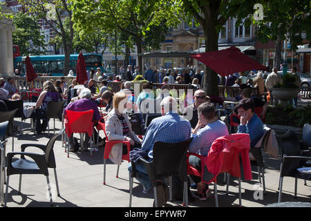 Southport, Merseyside, UK 23rd May, 2015. Cafe Patrons in the Town Gardens as Arts & Crafts demos are staged in - Stock Photo