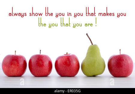 Row of fruit with Always Show the You in You quote concept, with one large green pear in row of small red apples, - Stock Photo