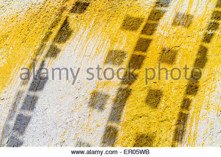 The shadows of prayer flags are shown against the side of Boudhanath Stupa in Kathmandu, Nepal - Stock Photo