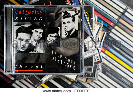 Curiosity Killed the Cat 1987 debut album Keep Your Distance, album, piled music CD cases, England - Stock Photo
