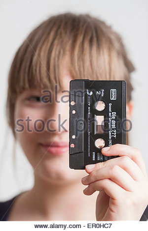 girl with audiocassette - Stock Photo