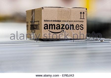 Amazon packages on conveyor belt - Stock Photo