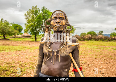 Warrior from the african tribe Mursi with traditional horns in Mago National Park, Ethiopia. - Stock Photo