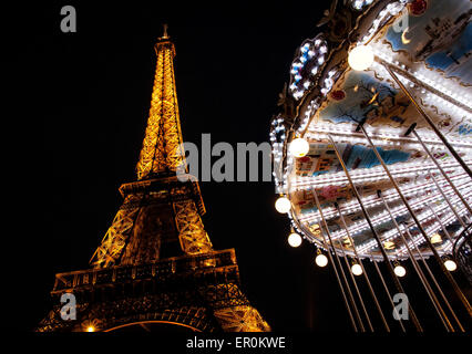 The Eiffel Tower and carousel at night. Paris, France - Stock Photo