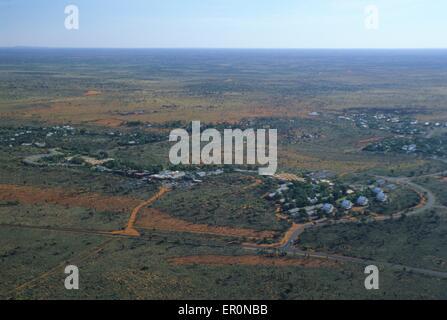Australia, Northern Territory, Uluru Kata Tjuta National park, Yulara accommodation village (aerial view) - Stock Photo
