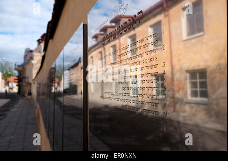 Constitution of Uzupis, posted in a mirrored plaque on the wall on Paupio gatve in different languages in Uzupis - Stock Photo