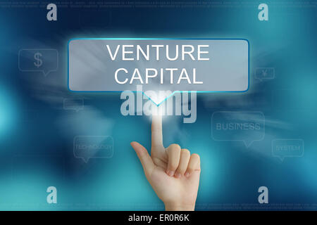 hand pushing on venture capital balloon text button - Stock Photo