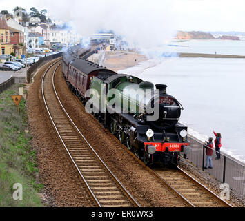 Waving to the steam train. The Cathedrals Express to Kingswear, hauled by LNER Class B1 No 61306 Mayflower. - Stock Photo