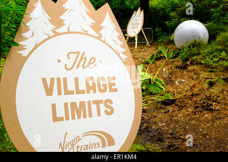 Virgin Trains sign, states 'The Village Limits' in the woods. During Festival No.6. In Portmeirion - Stock Photo