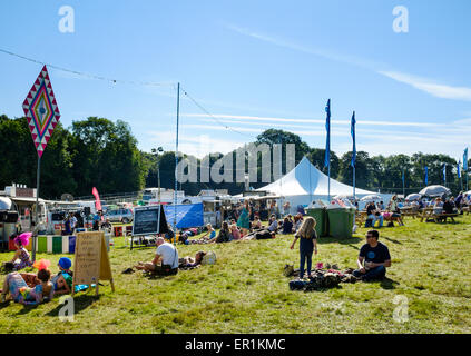Festival attendees taking time out, sitting on the grass, during Festival No.6. In Portmeirion, North Wales - Stock Photo