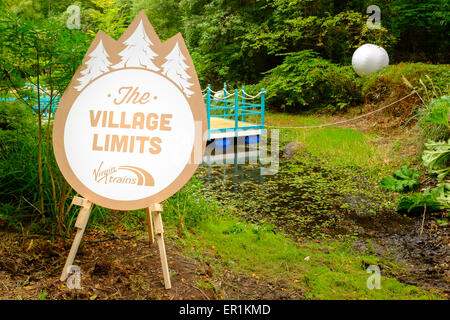 Virgin Trains sign, states 'The Village Limits' in the woods. During Festival No.6. In Portmeirion, North Wales - Stock Photo