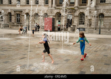 Somerset House. Children playing in the fountains. - Stock Photo