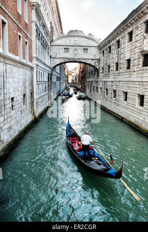 Gondola approaching the Bridge of Sighs or Sospiri Bridge in Venice, Italy, used to transfer prisoners - Stock Photo