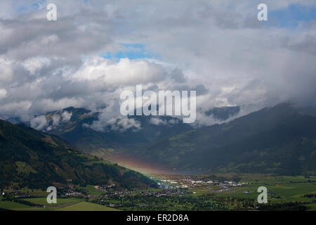 Rainbow and storm The valley of The River Salzach between Kaprun and Zell am See Pinzgau Salzbergerland Austria - Stock Photo