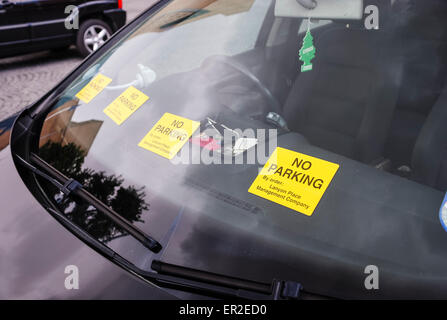 Four no-parking stickers applied to a car which has been illegally parked. - Stock Photo